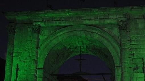 L'Arco d'Augusto s'illumina di verde per ricordare la lotta all'ictus